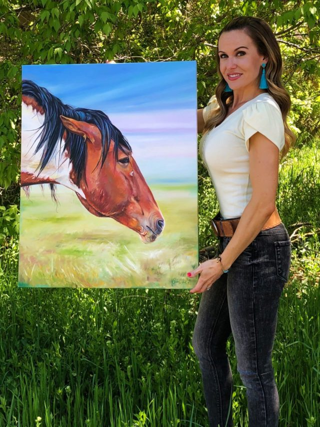 Artist Andrea Kirk with beautiful horse painting